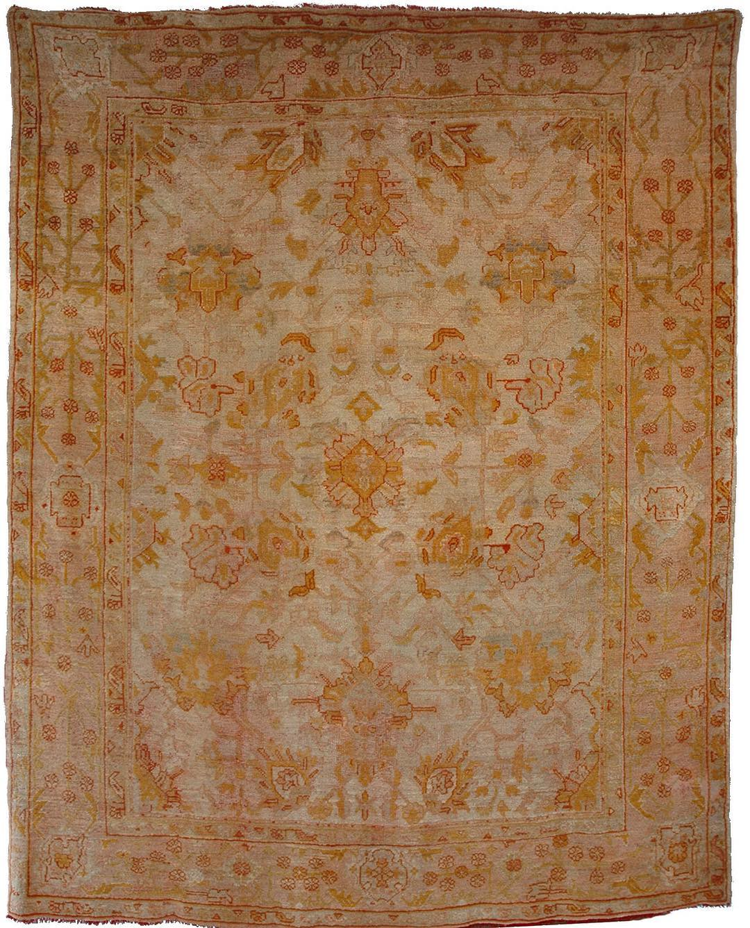 A 19th Century Turkish Ushak Carpet. 345...
